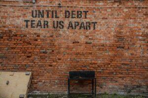 until debt tears us apart on wall
