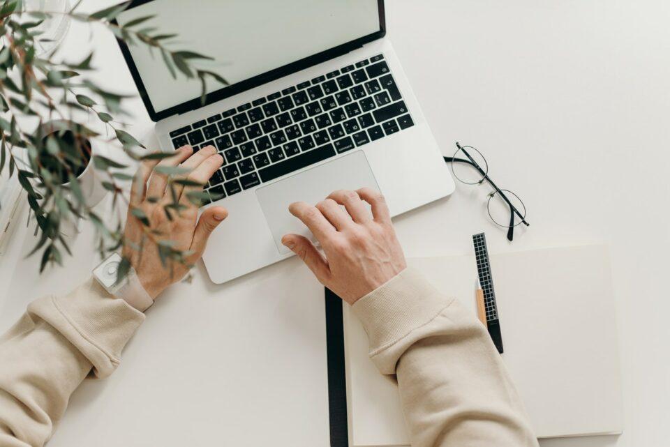 writing on laptop
